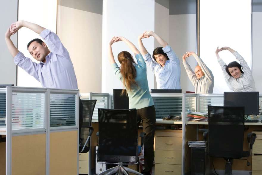 Office workers stretch before they get back to work